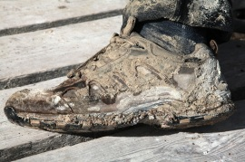 Muddy shoes after sinking knee deep into the very sticky mud