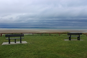 Park benches and sandy beach in Enniscrone, County Sligo, Ireland