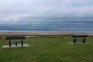 Park benches and sandy beach in Enniscrone, County Sligo, Ireland