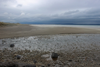 A rainy day at the sandy beach in Enniscrone, County Sligo, Ireland