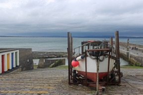 Small pier and boat at the harbour in Enniscrone, County Sligo, Ireland