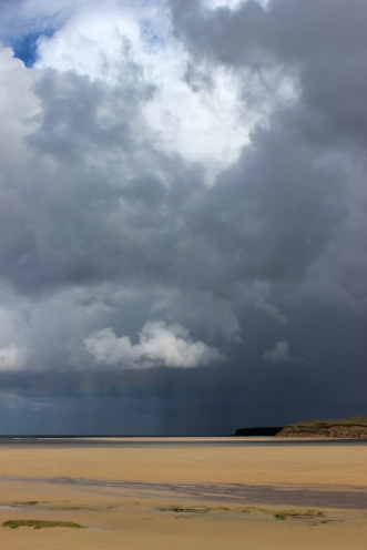 Rain shower over lovely strand called Lacken, County Mayo, Ireland