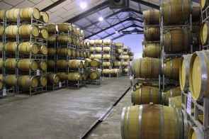 Racks with wine barrels at Fairview Wine and Cheese, Stellenbosch, South Africa
