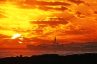 Sunset tele-view over Cape Agulhas from the Marine Drive in Struis Bay, Western Cape, South Africa