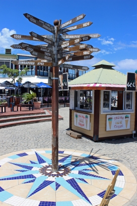Knysna Waterfront with signpost showing various worldwide cities - Knysna - South Africa