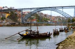 Dom Luís I bridge in Porto, Rabelo boats on the river Douro