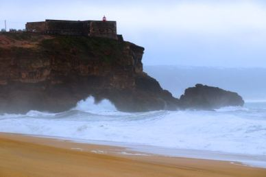 view of the Farol da Nazare, Lighthouse of Nazare, view from Praia do Norte, North Beach, Nazare, Silver Coast, Portugal